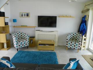 The lounge - a view of the beach and a great place to relax, read a book, watch TV ..your choice