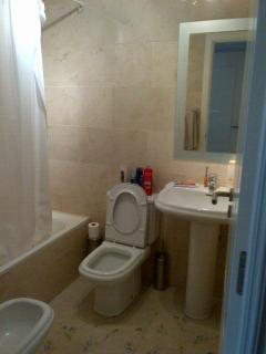 Ensuite bathroom to main bedroom with bath shower toilet sink and bidet