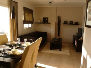 sitting room with large sofa bed, dining table, satelite TV (all UK chanels), IPod docking station,