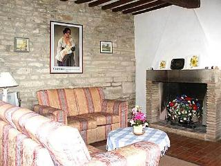 The sitting room with comfy settees and a real fireplace for chilly evenings