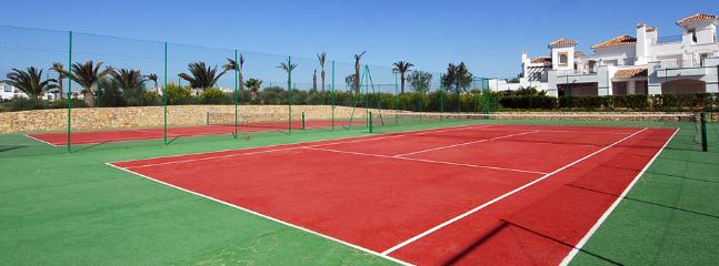 Tennis courts, enjoy the free bikes and rackets