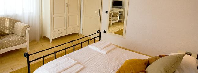 Master Bedroom with double bed, wardrobe, drawers and TV
