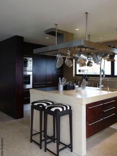 open kitchen with 2 fridges, 2 ovens, Magimix, dishwasher, etcetera