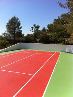 Private tennis courts within the villa grounds