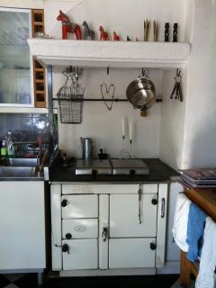 There is also a fireplace in the kitchen, an old AGA stove.
