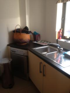 Utility Room with washing machine/dryer/freezer, dvd collection and pull out storage
