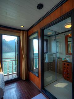 The bathroom of deluxe cabin, very comfortable, with large sea view by big window.