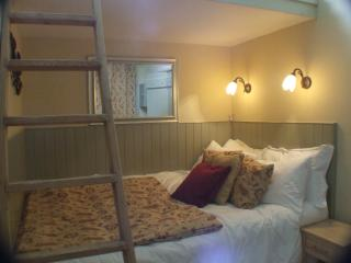 Double bedroom with ladder to loft space