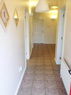 The hallway as you enter via the front door.