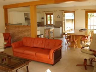 picture looking from lounge over to dining area and kitchen
