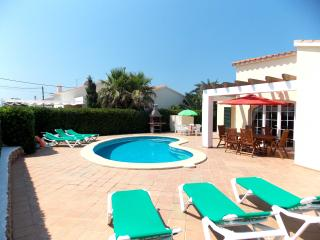 Private spacious sunbathing terraced and pool area from right to left