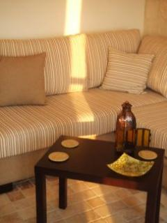 The stylishly furnished living/kitchen room with balcony