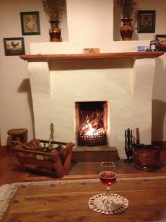 An evening sitting in beside a cozy log fire in Primrose Cottage