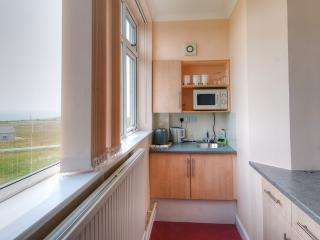 Galley kitchen with stunning sea views from the window. Complimentary tea, coffee. Mini grill/oven.