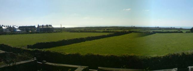 The view to the sea over farmland - great for watching the sunsets