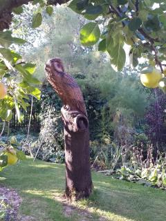 Tree sculpture of an owl in the garden