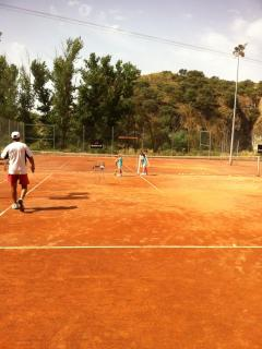 The tennis courts at the local sports club you can book at a fee