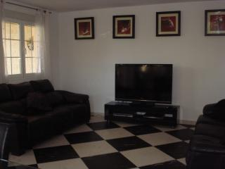 Comfortable lounge with leather sofas and flat screen TV