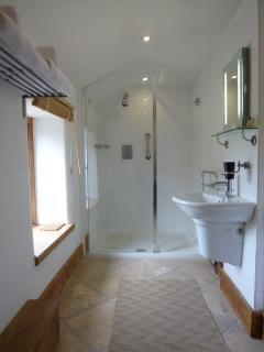 Large walk-in shower, toilet and basin with quality towels and toiletries provided