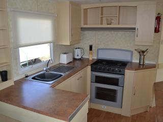 Kitchen with all required utensils, microwave, fridge, toaster and kettle.