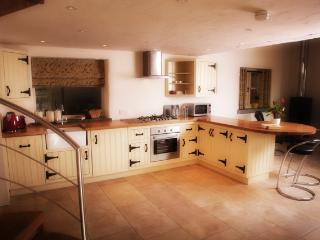 The well equipped kitchen in the spacious open plan area