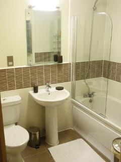 Modern bathroom with shower & heated towel rail