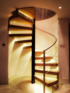 The master bedroom and ensuite is accessed by the attractive spiral staircase