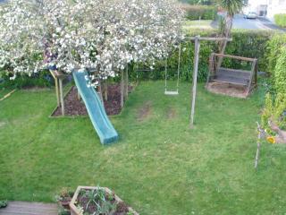 Rear garden w/ green behind