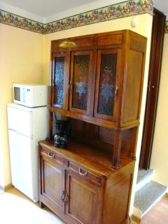Dresser with fridge, freezer, and microwave