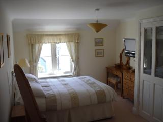 The master double is en-suite. It's a lovely sunny room, dual aspect, with matching furniture a