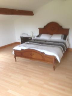 main double bedroom with wardobe overlooking garden