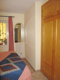 Casa Charlotte Ground floor bedroom with heating plate and wardrobe