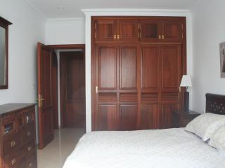 Master bedroom with en-suite bathroom, air con and king-size bed