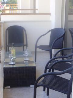 relax on the patio with a sea view, balcony surrounds apt, access from bedrooms & living room