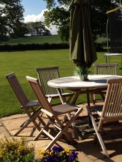 Large lawns from patio table chairs sunloungers inlcuding  BBQ  for those warm  summer days- enjoy!