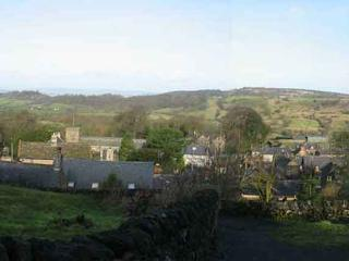 The spectacular view from the cottage overlooking the village and the beautiful Peak District countr