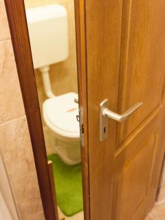 Privacy door on toilet
