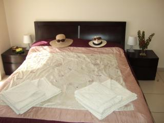 Luxurious King Size Bedroom with doors to patio - His and Hers !