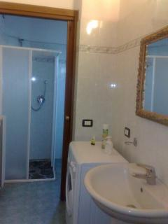 Second bathroom with large shower box ,wc, bidet, wash-hand-basin and washing machine