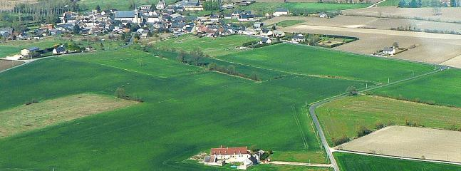 The property with Village in the background - away from the hustle and bustle of town life.