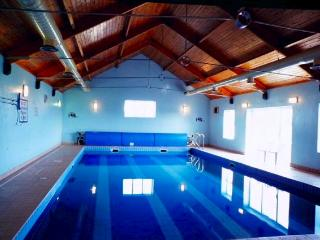 Quilty Holiday Cottages swimming pool shred with other guests.