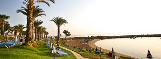 Local beach 7 minutes walk (0.7km) from Villa ideal for young children