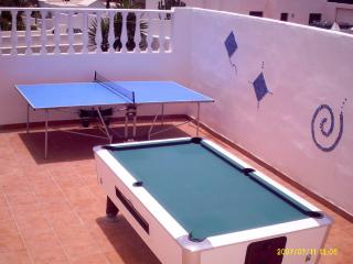 Outdoor enclosed games area with pool table, table tennis