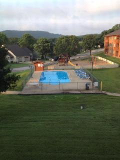 View from Patio of Outdoor Pool and Ozarks