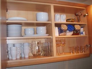 Well stocked kitchen cupboards.