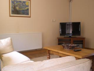 Lounge area, with TV, DVD player and stereo.