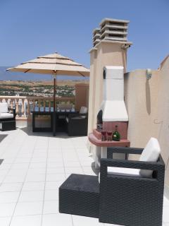 Large spacious private upper terrace with BBQ, ideal for soaking up the all day sun as you relax .