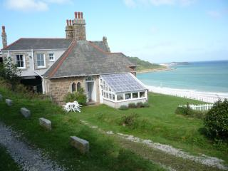 The cottage and conservatory and grounds with St Ives in the distance (20 minutes away)