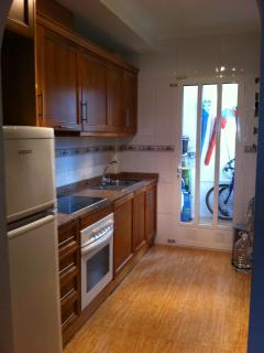 Kitchen leading to rear utility