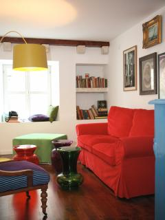 Living room - red sofa, Starck coffee tables, antique chair, Twiggy lamp